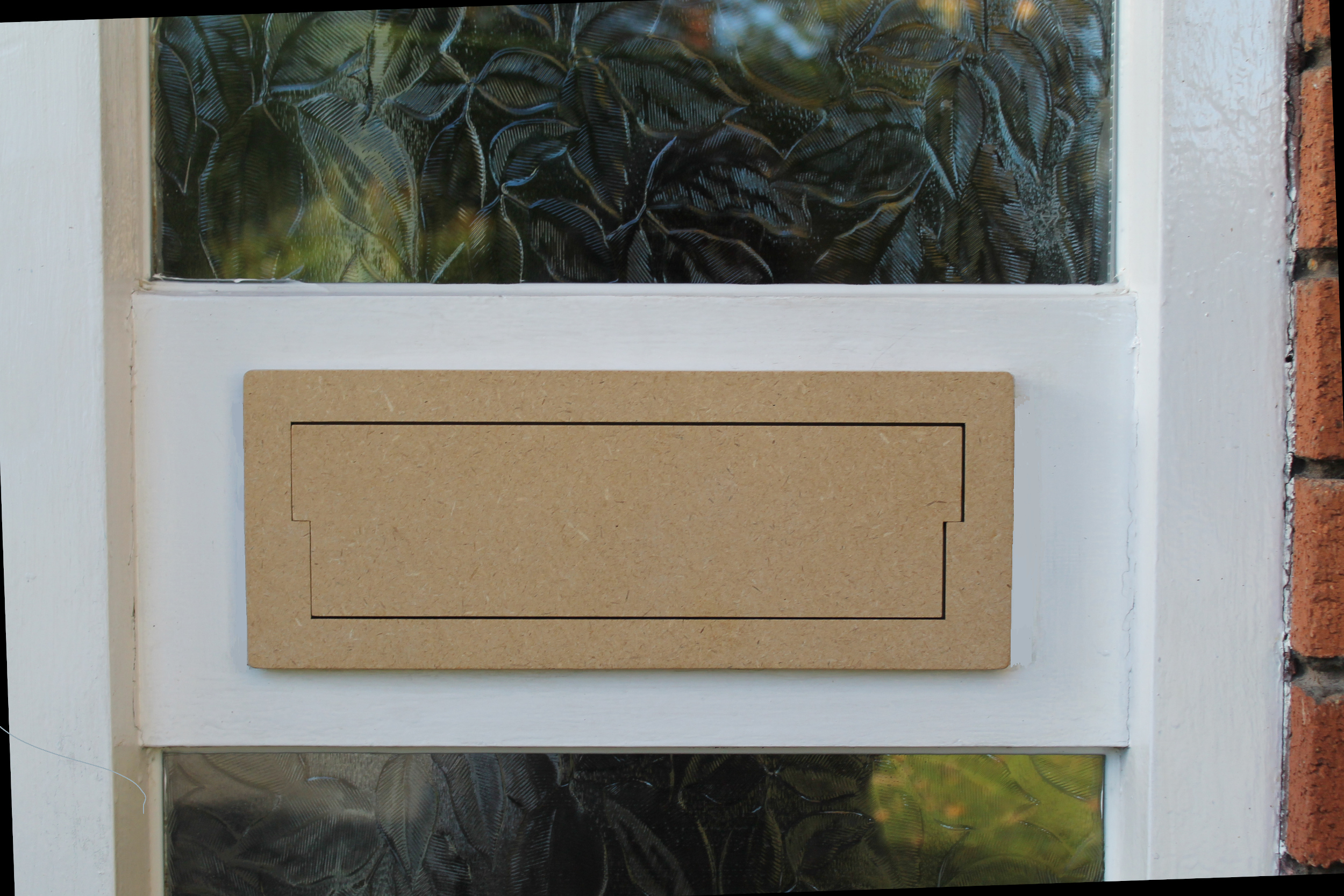 naked tricoya Letterplate Eco on door